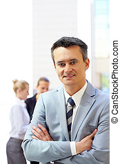 Employer - Portrait of attractive male in suit looking at...