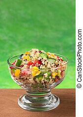 Delicious vegetarian quinoa salad with bell pepper, cucumber...