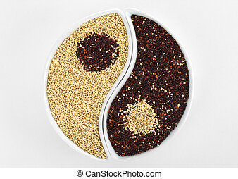 Yin and Yang symbol made of raw red and white quinoa grains...
