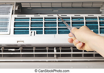 Fixing air conditioner - Shot of fixing air conditioner with...