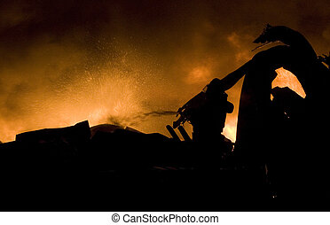 Danger work - Silhouette of firefighters