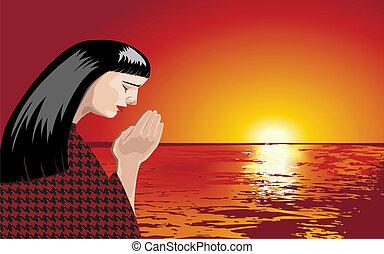 woman praying at sunset