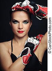 Woman in biker gloves