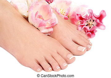 French pedicure - Close-up shot of beautiful woman feet with...