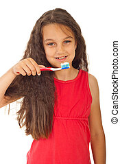 Smiling girl with toothbrush