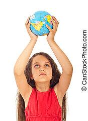 Girl holding world globe over head