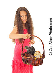 Beauty girl holding basket with chicken