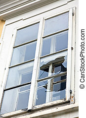 Broken window - A window with a broken window pane. Broken...