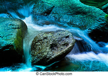 Bach in the water with stones and mountains - Creek with...