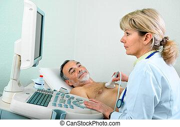Ultasound - Senior patient getting ultrasound from doctor