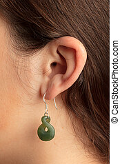 Woman ear with earring - Shot of young woman ear with...