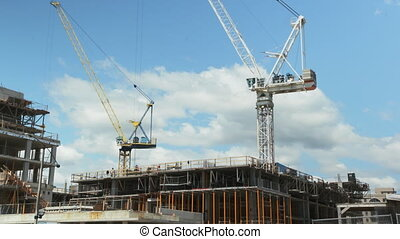 Two cranes. Wide. Timelapse. - Two tower cranes working....