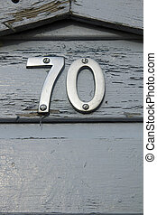 Seventy - Metal number 70 on grey-blue painted front door