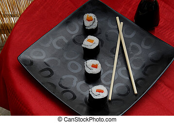 Vegetable sushi rolls - Four sushi rolls placed diagonally...
