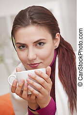 woman with cup tea - young woman with cup tea relaxed at...