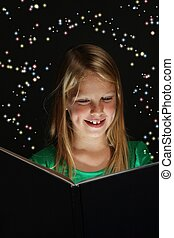 Young Girl Reading a Fantasy Book - Pretty young school girl...