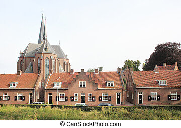 Curch overpowering houses in an Dutch village