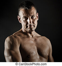 middle age man - An image of a muscular middle age man