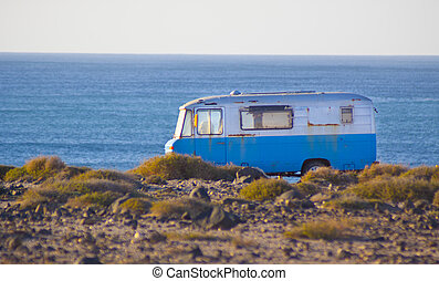 Retro camping van - An old, rusty, vintage, surfing,...