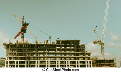 Condo construction Warm tint - Timelapse of cranes building...