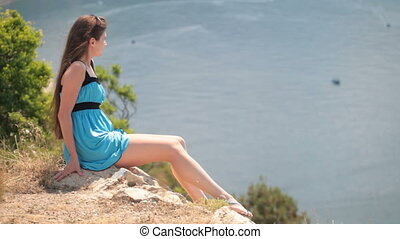 young woman resting on rock - young woman resting on the...
