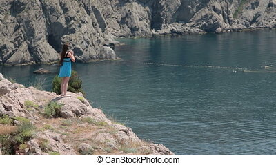 young woman standing on the edge of