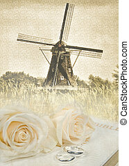 windmill wedding - Old Dutch windmill with wedding roses and...