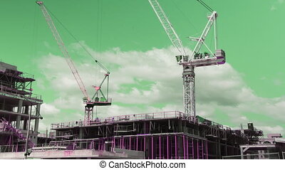 Punk cranes. Wide. Timelapse. - Two tower cranes working....