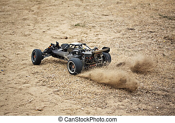 RC toy car rally - RC toy car driving on dry grass