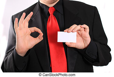 Business card and ok sign - Businessman holding a blank...
