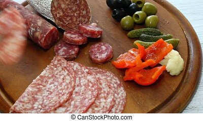 mixed appetizer with salami ,olives and pickles