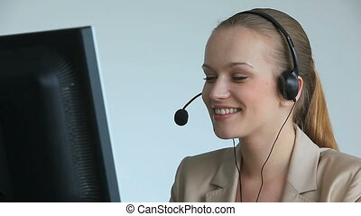 Operator at work - Call center operator answering a call