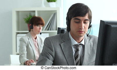 Handsome service operator - Handsome operator answering a...