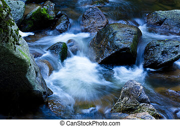 Bach in the water with stones and mountains - A cool stream...