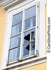 Broken window glass - A window with a broken window pane....