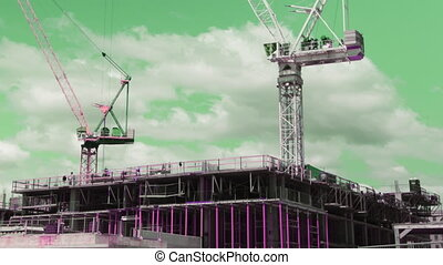 Punk cranes. Timelapse. - Two tower cranes working....