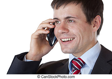 Close-up of a young businessman phoning happily with mobile