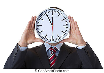 Executive holds clock in front of face as a sign of overload