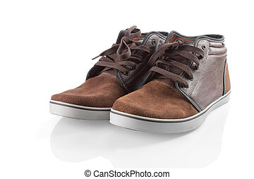 sneakers isolated over white - brown sneakers isolated over...