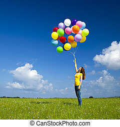 Girl with colorful balloons - Happy young woman with...