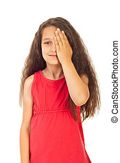 Girl covering one eye with palm for eyesight exam