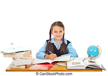 Happy schoolgirl writing at pupil - Happy schoolgirl sitting...