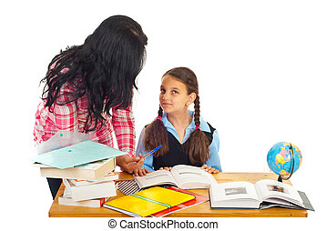 Mother asking girl about homework - Mother helping daughter...