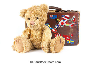 teddy bear and vintage old suitcase with world stickers -...