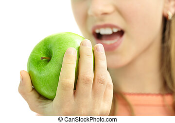 Eating apple - Close-up of fresh green apple in schoolgirls...
