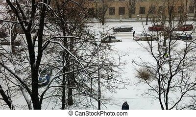 City street during snowfall,  aerial view