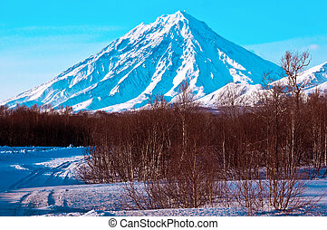 Volcano covered with snow - Beautiful snow-covered volcano a...