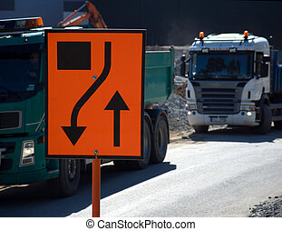 Roadworks with sign and trucks