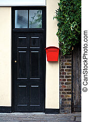 Door - Black door front entrance with red letter box