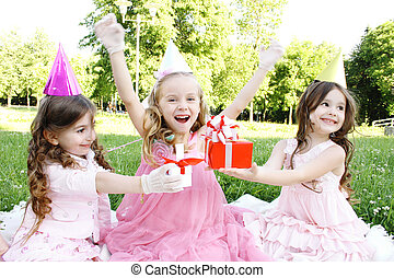 Childrens Birthday Party outdoors - Three young girls...